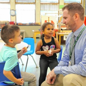 Greenfield Principal Jake Toomey and students