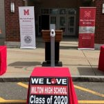 Some Massachusetts high schools are turning graduation into a drive-thru parade