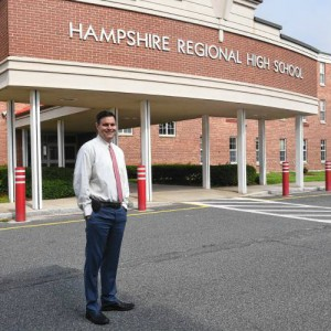Superintendent Aaron Osborne standing in front of Hampshire Regional High School